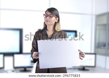Business Woman Holding a Blank Billboard - stock photo