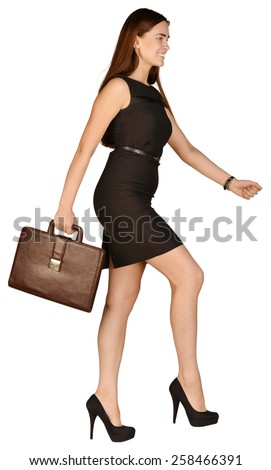 business woman holding a briefcase in his hand going forward. - stock photo