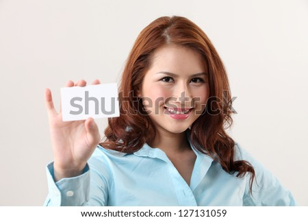 Business woman holding a card - stock photo