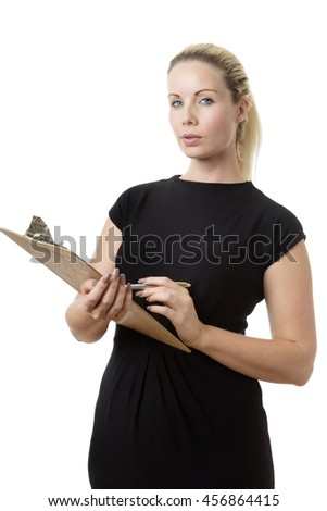 business woman holding a clip board and pen  - stock photo