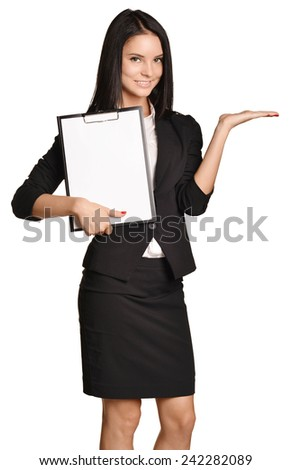 Business woman holding a clipboard in hand and the other put aside - stock photo