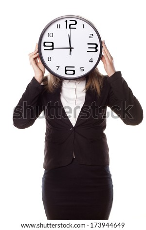 business woman holding a clock at the height of her head