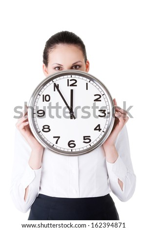 Business woman holding a clock in front of her face. Isolated on white.  - stock photo