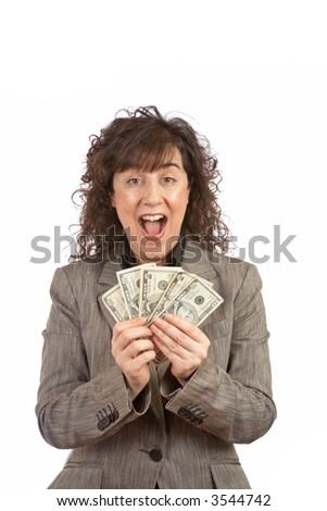 Business woman holding a fan of money over a white background. Eyes on focus, shallow DOF - stock photo
