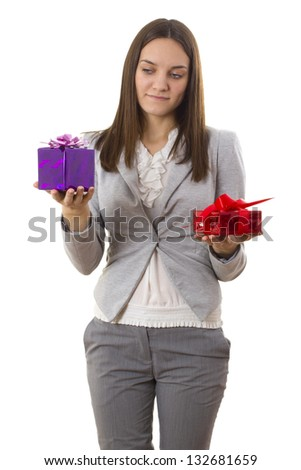 Business woman holding a gift isolated on white background