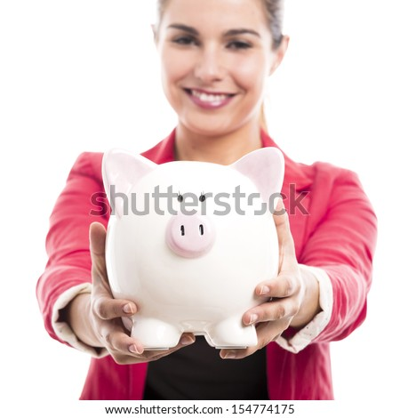 Business woman holding a piggy bank on the hands, isolated over a white background - stock photo