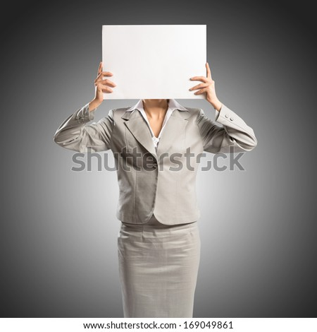 business woman holding a poster, place for text