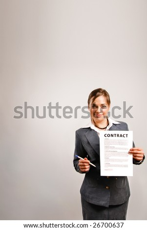 Business woman holding a printed contract - stock photo