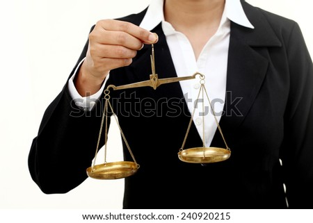 Business woman holding a scales of justice - stock photo