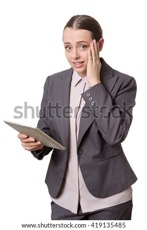 business woman holding a tablet computer with a worried, concerned expression on her face.  Isolated on white.