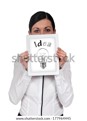 Business woman holding a tablet with the face and the screen idea - stock photo