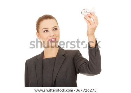 Business woman holding airplane model. - stock photo