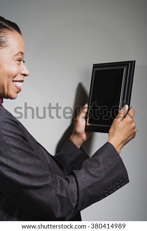 Business woman holding an award - stock photo