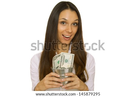 Business woman holding an iron bucket with dollars. Isolation - stock photo