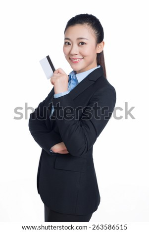 business woman holding and showing her credit card isolated on white background - stock photo
