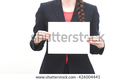 Business woman holding blank sheet of paper - stock photo