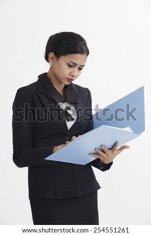 business woman holding business file