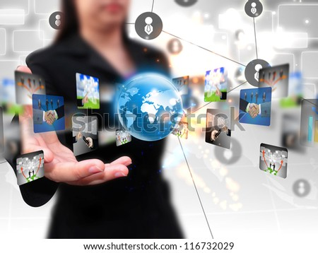 business woman holding business world - stock photo
