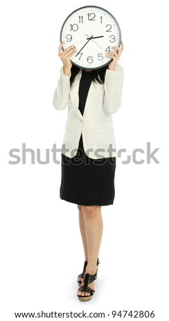 Business woman holding clock cover her face, full length portrait isolated on white background. - stock photo
