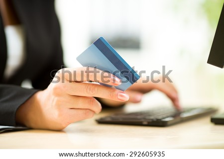 business woman holding credit card on laptop for online payment concept - stock photo