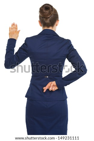 Business woman holding crossed fingers behind back while oath truth . rear view - stock photo
