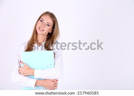 Business woman holding folder, isolated on white - stock photo