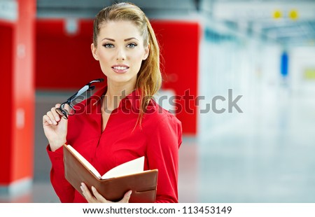 business woman holding glasses and looking at camera. Copy space - stock photo