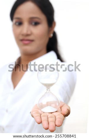 Business woman holding hourglass-Concept of timing - stock photo