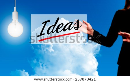 Business woman holding idea sign - business concept - stock photo