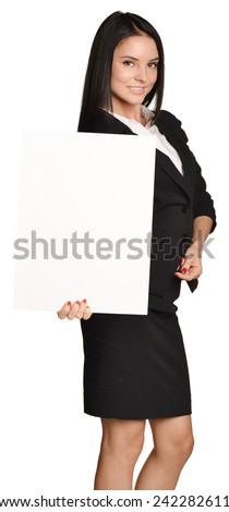 Business woman holding in hand a blank sheet of white cardboard paper