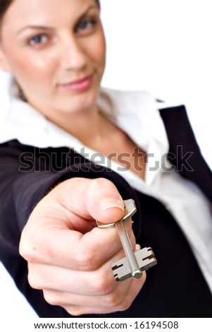 Business woman holding key - stock photo