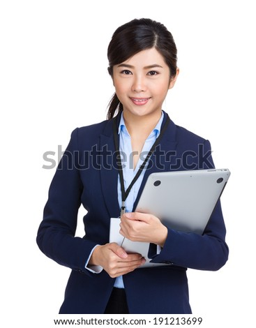 Business woman holding laptop