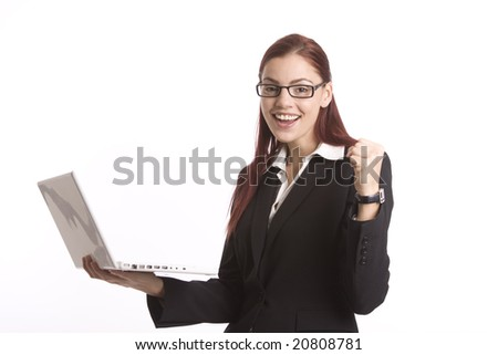 Business woman holding laptop computer and looking happy - stock photo
