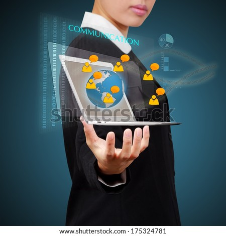Business woman holding laptop show a social network on virtual screen. Concept of business communication. - stock photo
