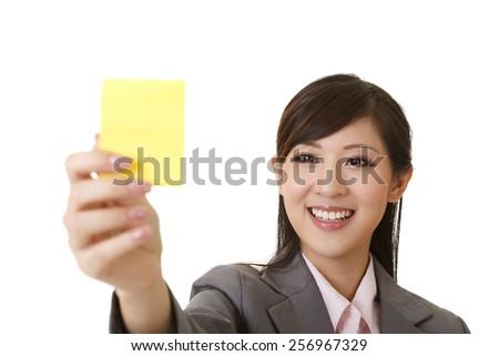 Business woman holding one yellow memo stick, closeup portrait on white. - stock photo
