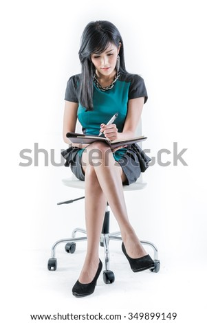 Business woman holding paper and pen working sitting on chair. - stock photo