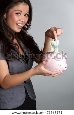 Business woman holding piggy bank - stock photo