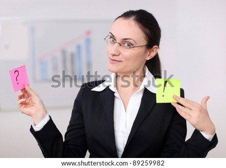 Business woman holding posits in an conference room. - stock photo