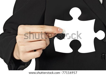 Business Woman Holding Puzzle Piece In Hand wearing suit - stock photo