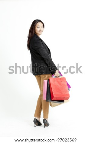 Business woman holding shopping bags against a white background