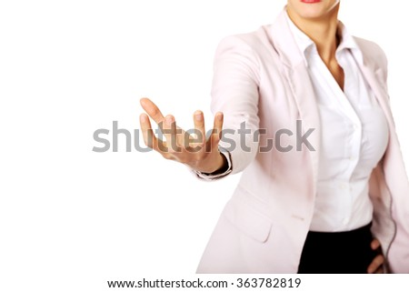 Business woman holding something on hand - stock photo