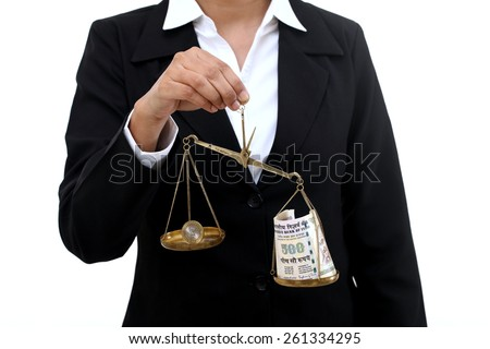 Business woman holding the justice scale- Money saving concept - stock photo
