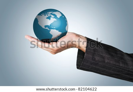 Business Woman holding the world in her hand - stock photo