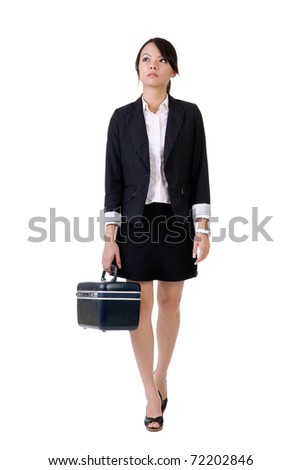 Business woman holding tools box and walking, full length portrait isolated over white. - stock photo