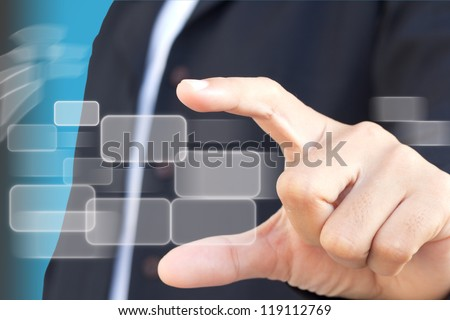Business woman holding touch screen - stock photo