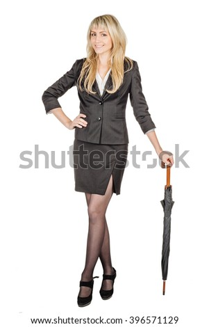 business woman holding umbrella with white wall background - stock photo