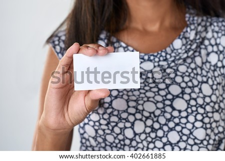 business woman holding up a blank card - stock photo