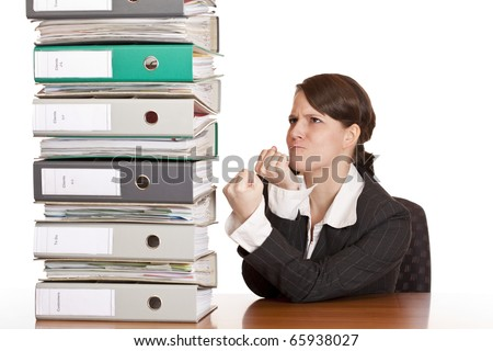 Business woman holds fists to file folder stack. Isolated on white background. - stock photo
