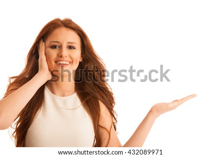 Business woman holds hand and points to copyspace as she would hold a product for commercial isolated over white background - stock photo