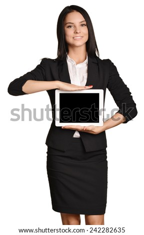 Business woman holds in hands mobile tablet - stock photo